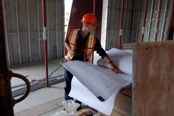 Founding faculty member on building site